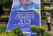 Photo of Ashanti NPP Delegates Conference littered with Alan Kyeremanten posters, billboards