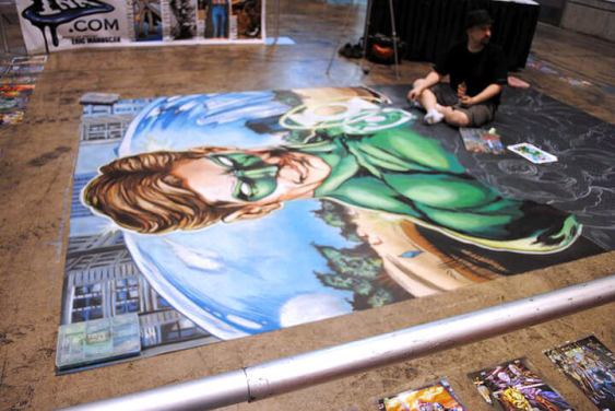 Chalk artist Eric Maruscak working on a Green Lantern mural at the Chicago Comic & Entertainment Expo.