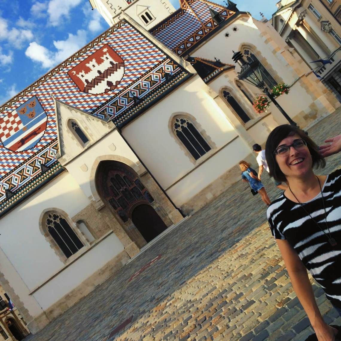 Posing in front of St. Mark's church in Zagreb, Croatia