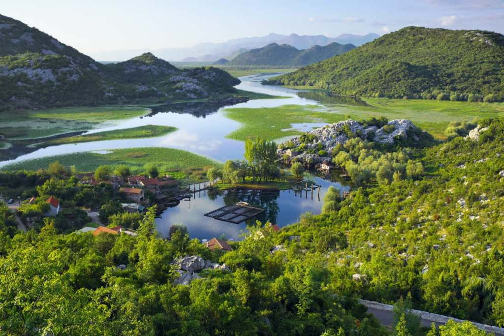 A beautiful view of Lake Skadar surrounded by lush greenery