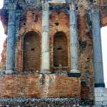 Columns, and alcoves in Greek theater ruins in Taormina, Sicily