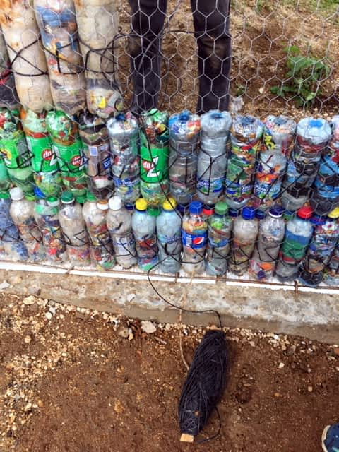 Completed bottles stacked and tied together at a bottle building school in Guatemala