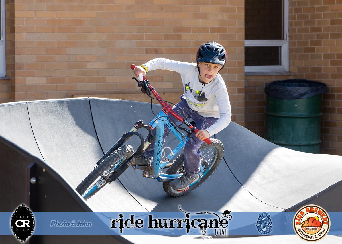 A boy riding a mountain bike on a pumptrack