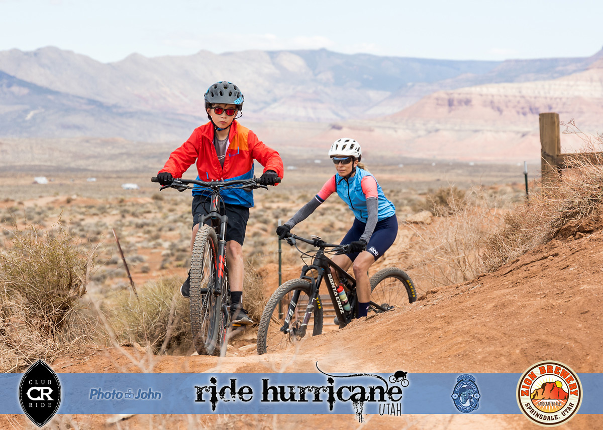 A boy and his mother riding mountain bikes in the Southern Utah desert.