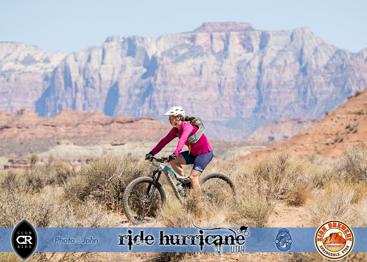 Lone mountain biker with Zion cliffs in the background.