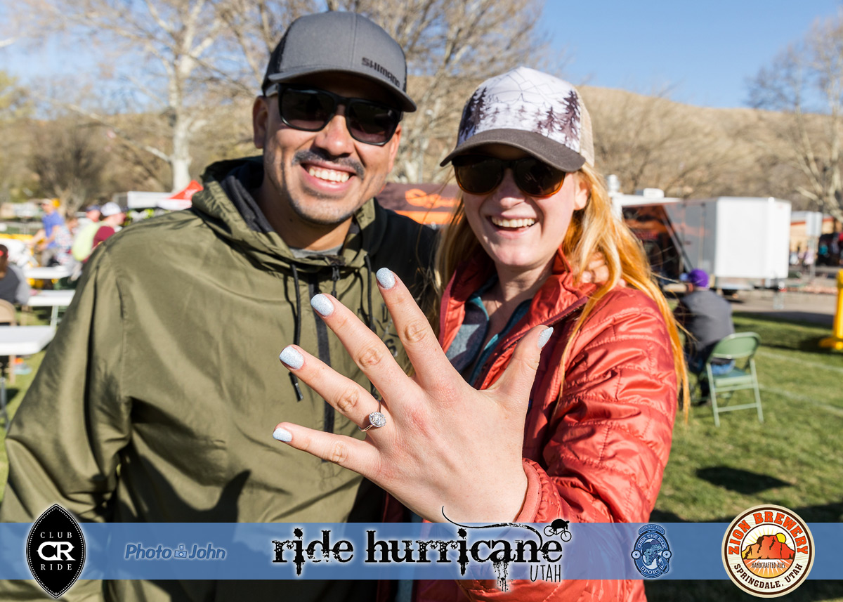 A mountain biker and her fiancee showing off her new engagement ring at the Hurricane MTB Festival