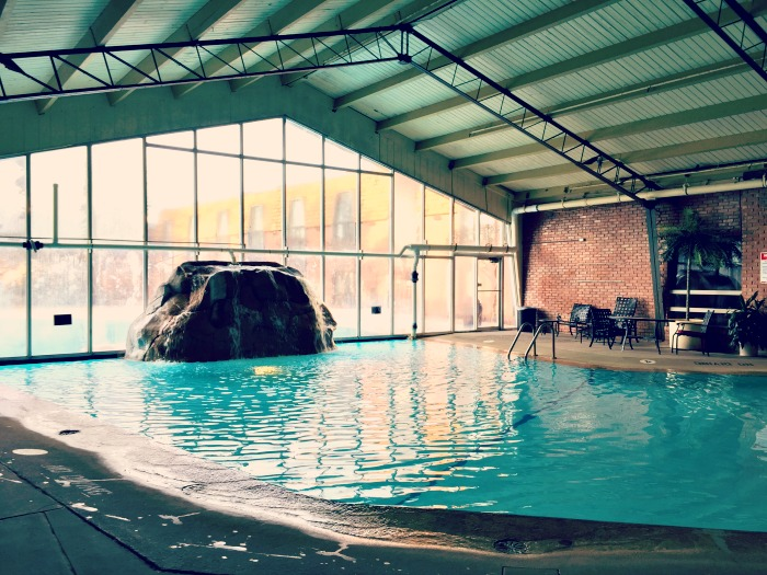 A review of the Pheasant Run Resort in St. Charles Illinois. The family-friendly property boasts an indoor outdoor pool. Swim underneath an opening to reach the other side.