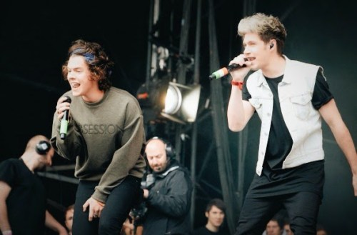 Harry Styles of One Direction in Calvin Klein Collection Obsession sweatshirt and Niall Horan at Radio 1 Big Weekend at Glasgow Green on 24 May 2014