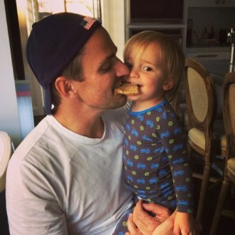 The Rancic's checked in with their adorable pic of Duke and dad Bill Rancic playing a game of survival of the fittest over a pancake