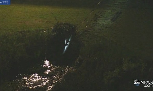 teens drive into cemetary pond and die