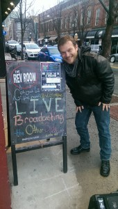 Mike is happy to see the Revolution's sandwich board with our show on it!