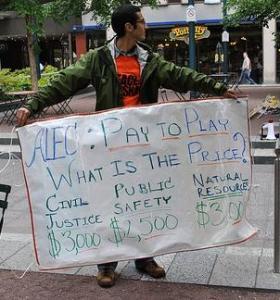 An anti-ALEC protester in Cincinnati. (Mark Haller / Flickr)
