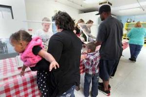Homeless families line up for dinner at the Valley Resort Shelter in Hemet, California, April 5, 2012. (Photo: Monica Almeida / The New York Times)