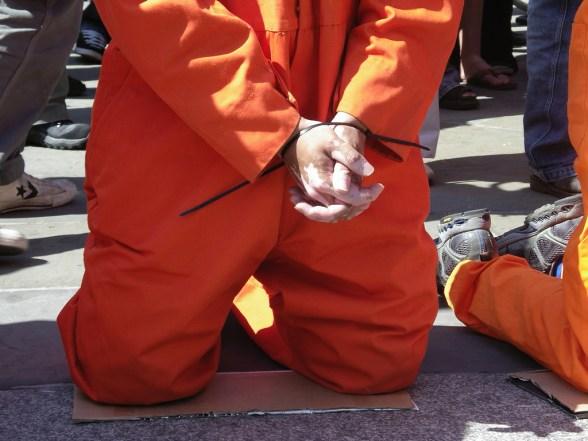 Guantanamo-prisoner-detainee-hands-tied-torture-gitmo