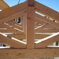 Ojai installing timber frame trusses in an icf house