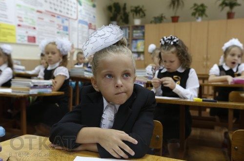 Students attend their first lesson of the day in a school in the southern coastal town of Mariupol