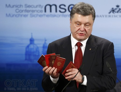 Ukraine's President Poroshenko holds Russian passports to prove the presence of Russian troops in Ukraine as he addresses during the 51st Munich Security Conference in Munich