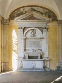 The Renaissance funerary monument of Edward Carne in the courtyard of San Gregorio Magno.