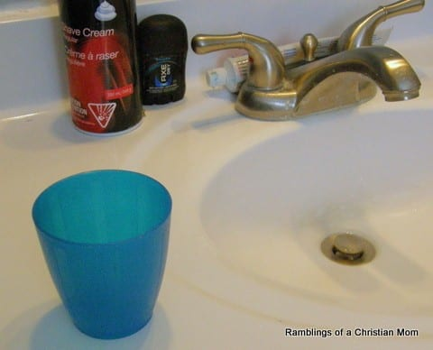 A cup in the bathroom sink makes it easier for kids to get themselves a drink of water on their own.