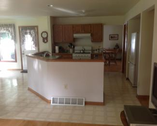 kitchen entry doors target furniture nadeau remodel repeat finished installation of new drywall paint vinyl tile floor cabinetry and solid surface countertop there will also be exterior installed