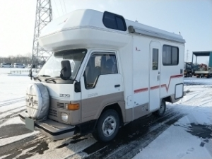 This is a 1991 Toyota Hiace Fiberglass Camper with a 5 speed, 4x4.
