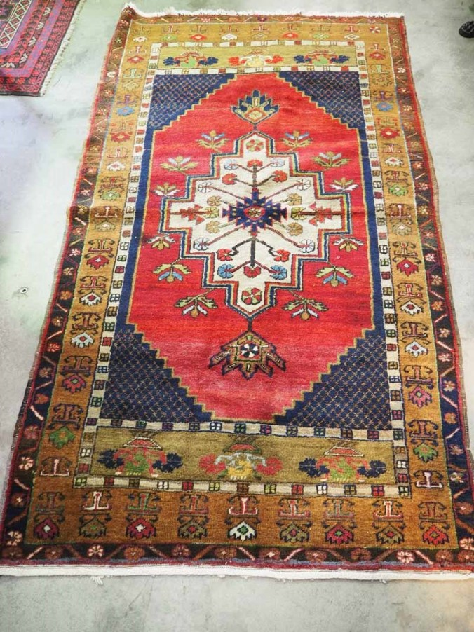Hand knotted wool on wool Turkish Carpet from Taspinar. Approximately 40 years old