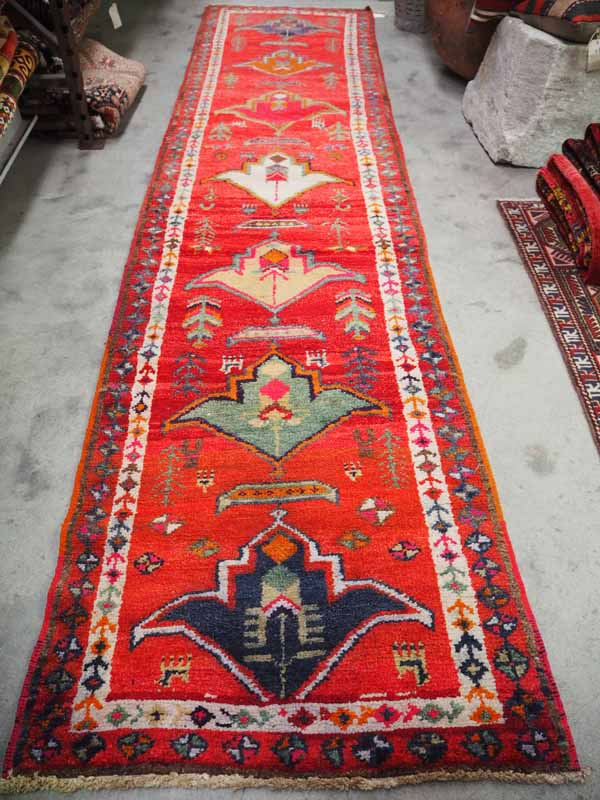 Wool on wool hand knotted Iraqi Kurdish runner. Approximately 60 years old