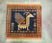 Finely knotted hand made wool on wool Peacock mat from Persia. Approximately 50 - 60 years old