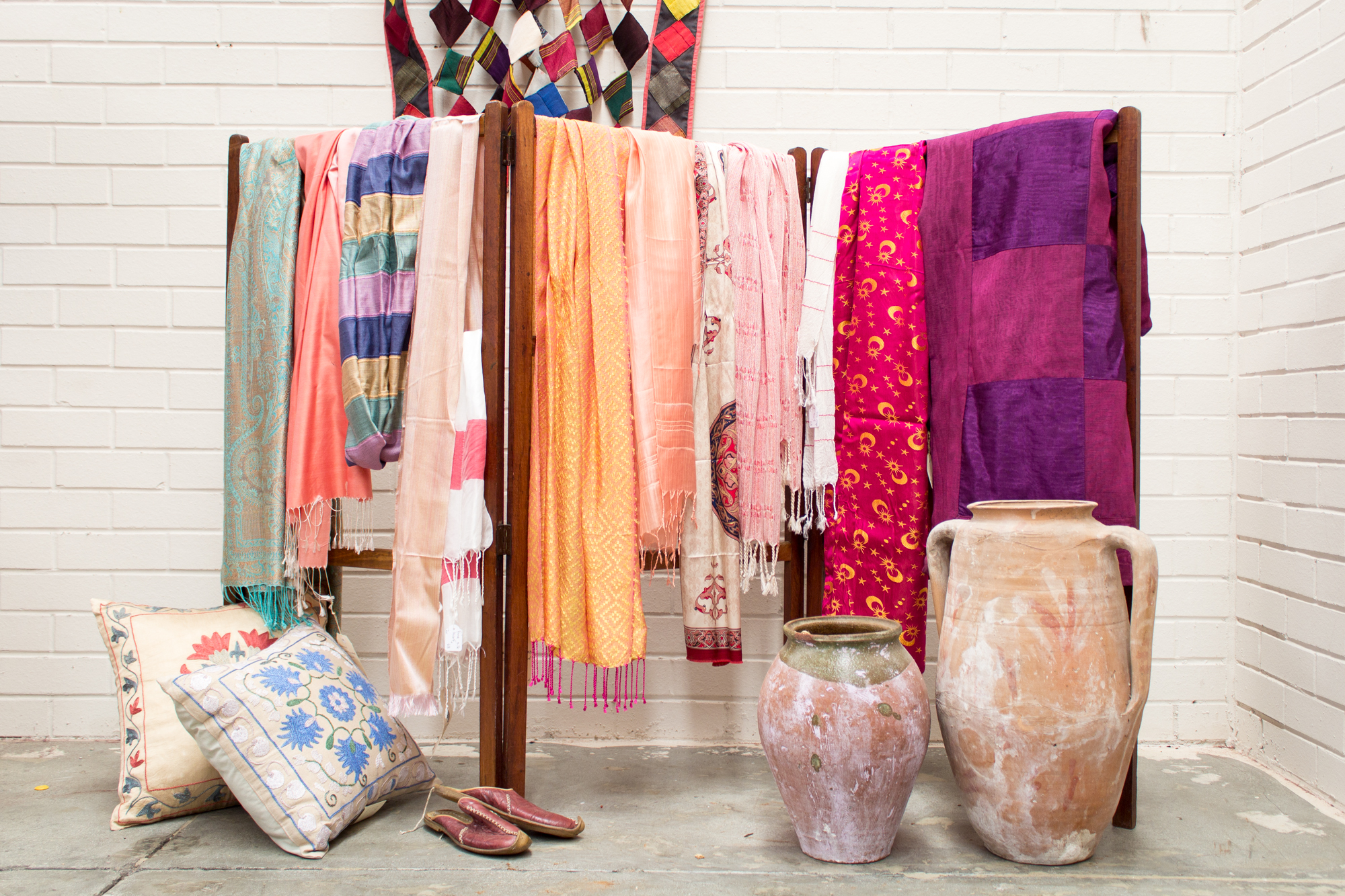 Anatolian Pots and Urns with Embroiled Cushions and and assortion of silk scarves and fabrics