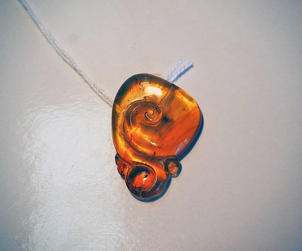 """Carved Burmese """"Pocket"""" amber"""