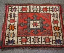 Hand knotted wool on wool Turkish small carpet from Anatolia, approximately 60 years old