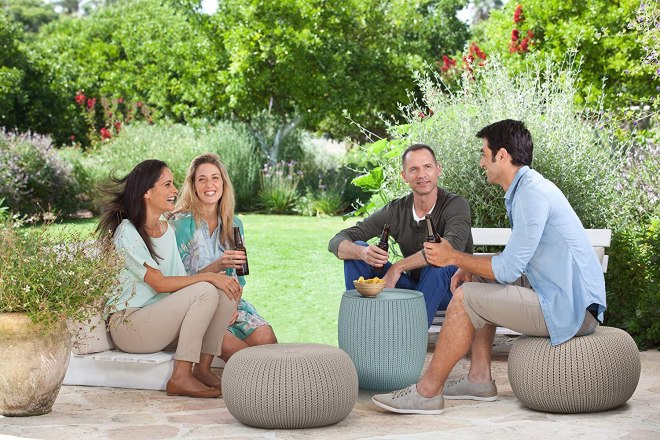 Folks sitting on knit ottomans outdoor