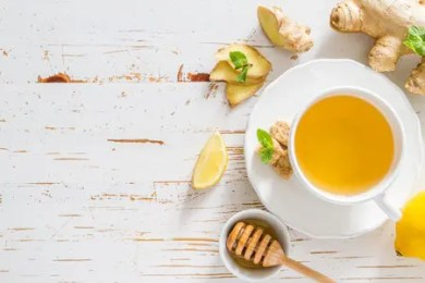 cup of ginger tea on a wooden table