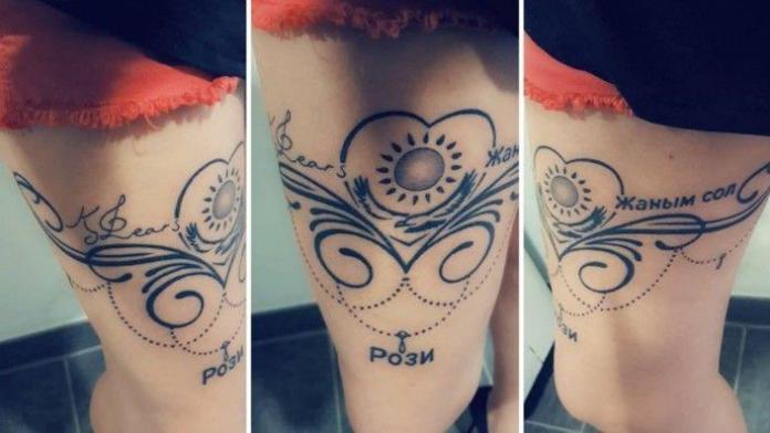 татуировки с именем Димаша Кудайбергена и казахстанским флагом