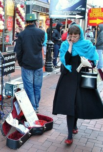 Another mime? No... just a lady with blue cape and red shoes...
