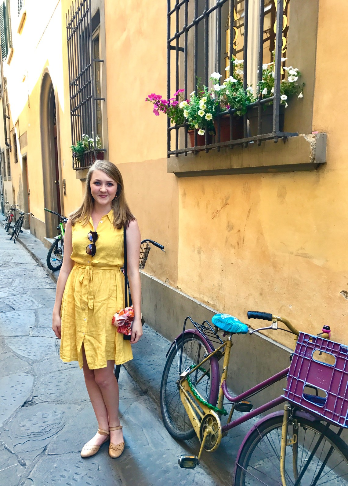 in yellow dress on side street in florence