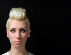 Female model with bleach blonde hair in a fashionable style