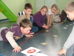 Young children playing the fish game