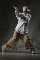 Teenager in hip hop street clothing