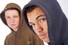 Two teenage boys in hoodies