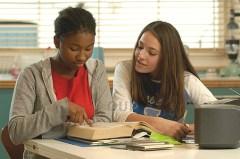 2 teens reading