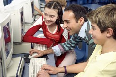 Teacher and students at computer