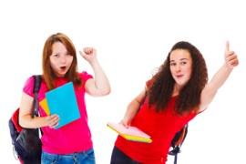 Happy teenage English students