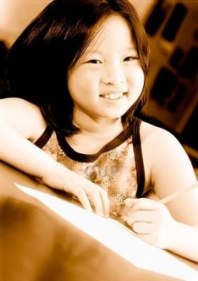 Girl smiling and writing