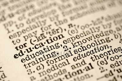 Closeup on dictionary entry for education