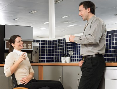 Office workers making small talk
