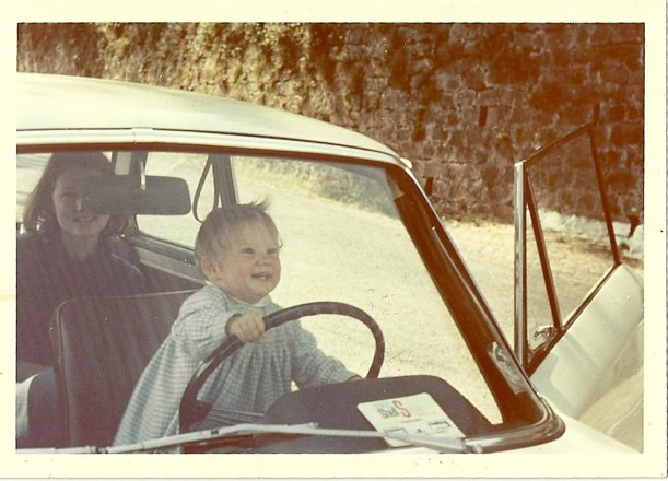 Kenna Bourke as a toddler 'driving' a car
