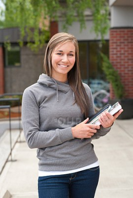 College student smiling holding books
