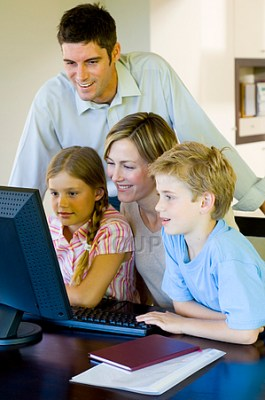 Family gathered round computer