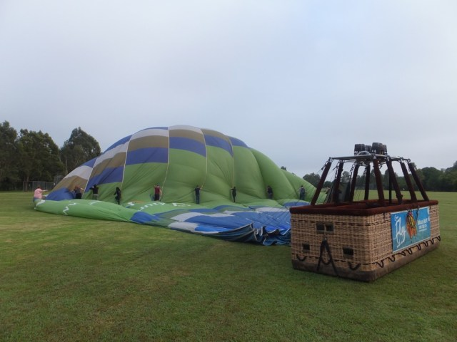 All helping to get the air out of the balloon before it gets rolled up.